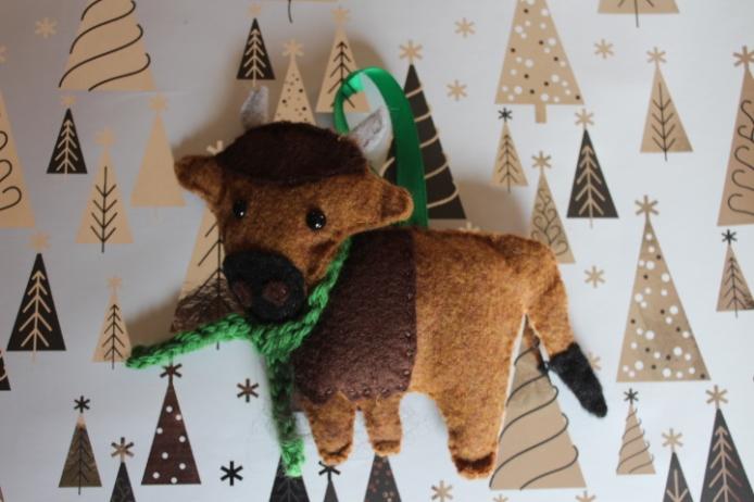 Felt bison ornament filled with Tunis fiber